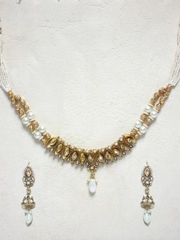 https://static4.cilory.com/43478-thickbox_default/elegant-polki-work-necklace-set-carved-with-stone-and-beads.jpg